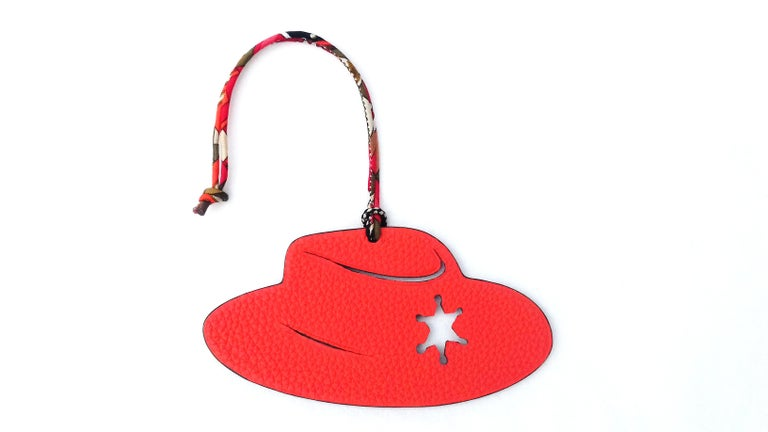 Super Rare Authentic Hermès Charm  Pattern: Sheriff Hat  Can be used as Bag Charm for your Hermès Kelly or Birkin Bag  The Pink side is made of Epsom Leather, the Orange side is made of Granied Leather  Colorways: Rose Confetti, Orange  Can be hung