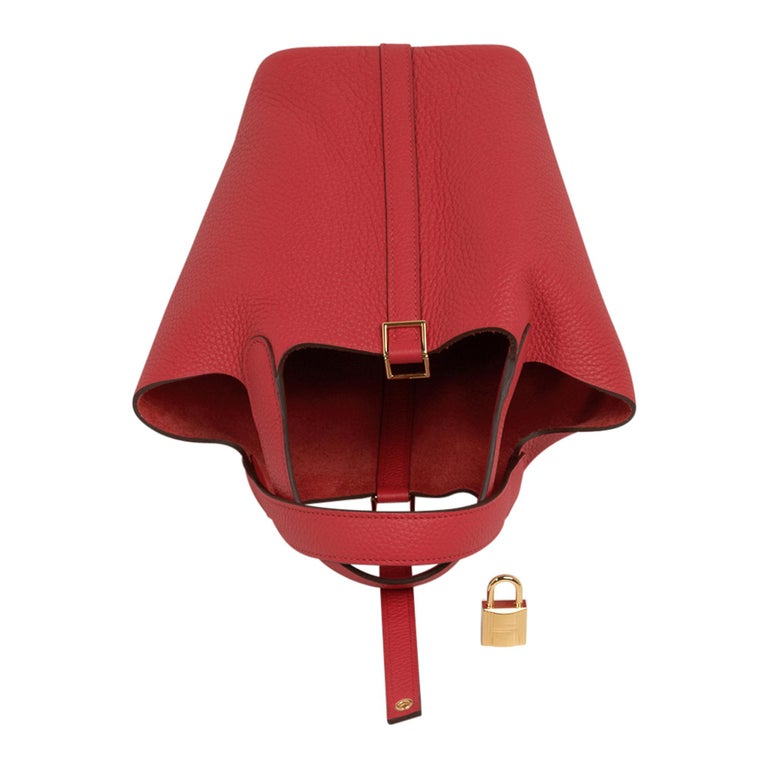 Guaranteed authentic Hermes Picotin Lock 18 tote bag featured in Rouge Tomate. Clemence leather with Gold hardware. This roomy small tote is a perfect go to bag!  Comes with lock and keys, sleeper, and signature Hermes box. NEW or NEVER WORN final