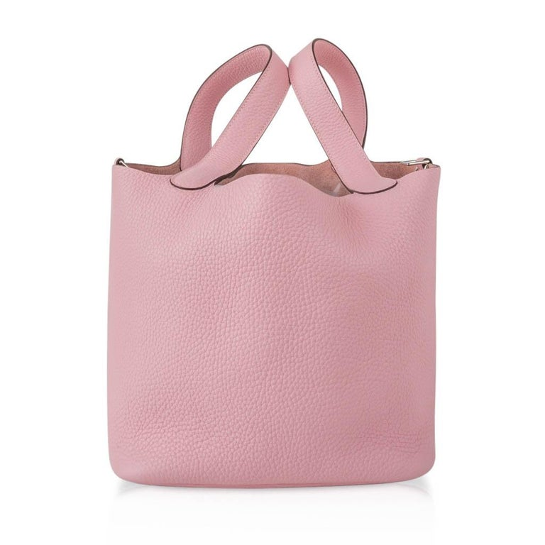 Guaranteed authentic Hermes Picotin Lock 22cm Rose Sakura in Clemence. Fresh with palladium hardware. This roomy small tote is a perfect go to bag!  Comes with lock, keys and sleeper. final sale  BAG MEASURES: LENGTH  22cm / 8.5