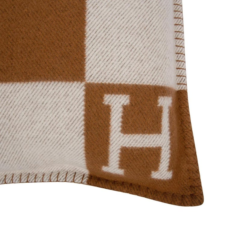 Guaranteed authentic Hermes classic Small Model Avalon signature H pillow in Camel and Ecru. The removable cover is created from 90% Wool and 10% cashmere and has whip stitch edges. Comes with sleeper.   *This listing is for one pillow only* Please