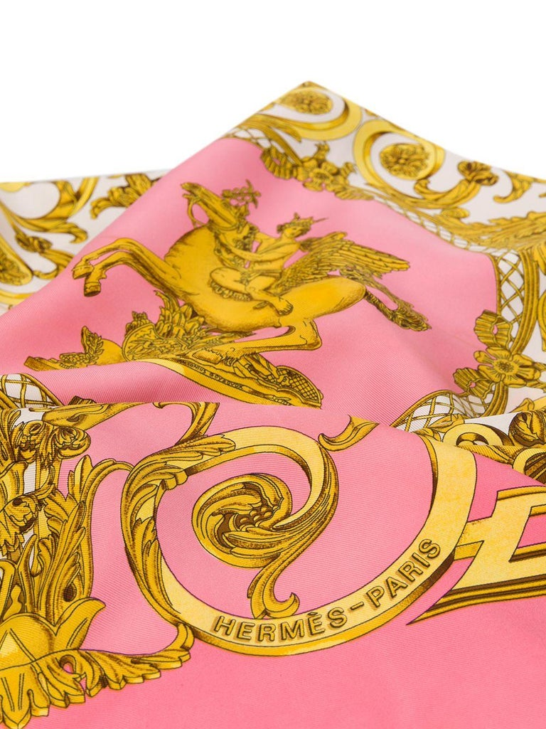 Crafted in France from the finest pink silk, this pre-owned scarf by Hermès features a lightweight construction, a square shape and an elegant, all-over 'baroque print' motif print in a contrasting shades of gold, white and grey. The piece is
