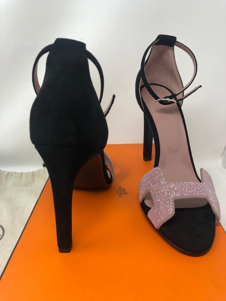 Hermes pink and black heels. Brand new never worn. European size 38.5 US size 8-8.5. Gorgeous shoes. Will include original Hermes box. Guaranteed authentic.