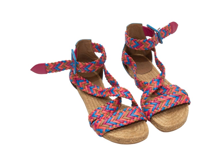 Product details: Pink, blue, orange, and tan woven leather espadrille sandals by  Hermes. Raffia and leather soles. Buckle closures at ankle straps. Designer size 35.  Condition: Pre-owned. Good. Scuffing and water stains at outer soles.
