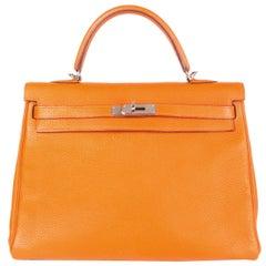 HERMES Potiron orange Clemence leather KELLY 35 RETOURNE Bag