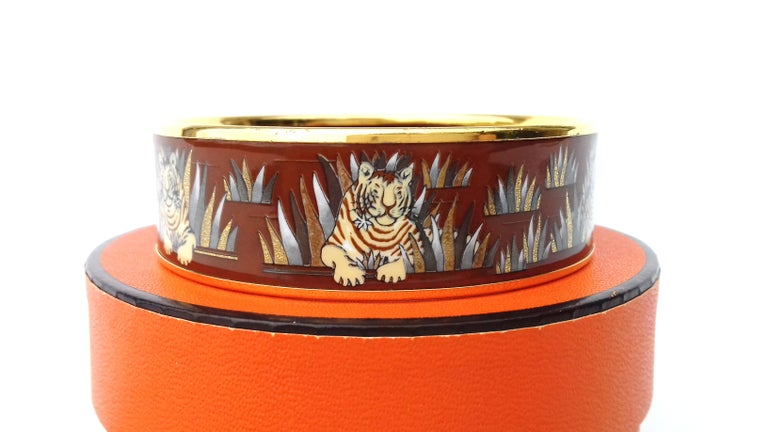 Extremely RARE and Beautiful Authentic Hermès Bracelet  Pattern: Tigers in the herbs  Designed by Joachim Metz in 1979   This bracelet may come from a reissue  The bracelet is decorated with 6 drawings of tigers  Made in Austria  Vintage Item  Made