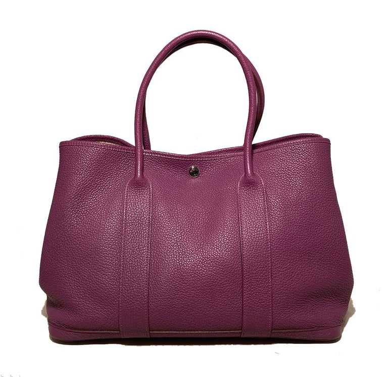 Hermes Purple Garden Party PM in excellent condition. Purple clemence leather exterior in signature garden party style. Top snap closure opens to herringbone canvas and leather interior with one side zipped pocket. No stains smells or scuffs. Clean
