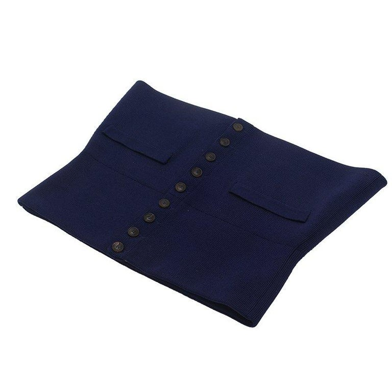 Slim down your waist and support your chest like never before with this comfortable Hermes Corset Belt. Made from silk and polyamide, the belt comes in a purple color and features a button closure at the front. The faux flap pocket design adds style