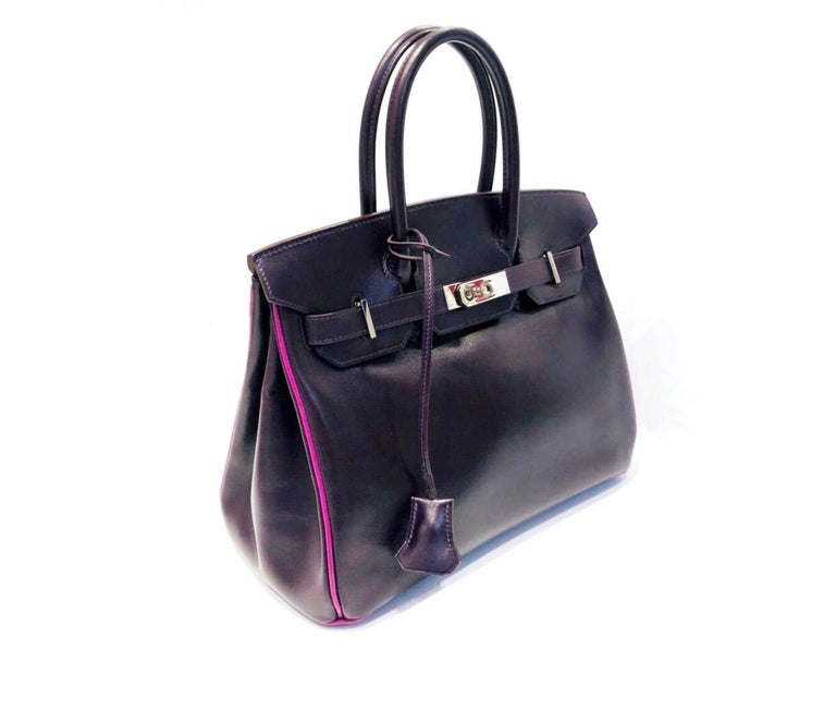 Hermès Raisin Birkin 30 Bag in Box Calf leather. This beauty is made of smooth and glossy calf skin that is more rigid than the grainy leathers, the box calf leather develops a highly desirable patina over time. Blind Stamp I in a square 2005.Inside