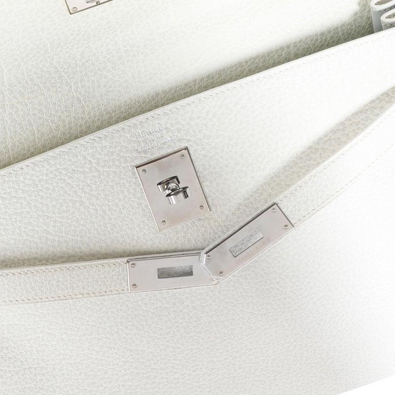 Hermès Rare White Dalmatian Retourne Kelly 35 PHW SKU: 111224  Handbag Condition: Very Good Condition Comments: Very Good Condition. Scratching to hardware. Brand: Hermès Model: Kelly Origin Country: France Handbag Silhouette: Shoulder Bag; Top