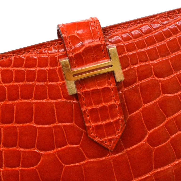 Hermes Alligator Exotic Leather 'H' Logo Palladium Evening Clutch Wallet Bag in Box  Alligator  Gold tone hardware Fold in buckle closure Leather lining Date code present Made in France Features zip closure, bill compartment and card slots  Measures