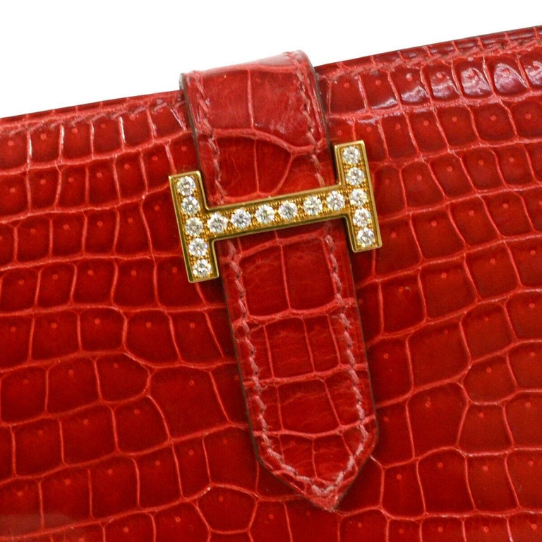 Hermes Red Crocodile Exotic Leather Diamond 'H' Gold Envelope Clutch Wallet  Crocodile Diamond Gold tone hardware Buckle closure Date code present Made in France Measures 7