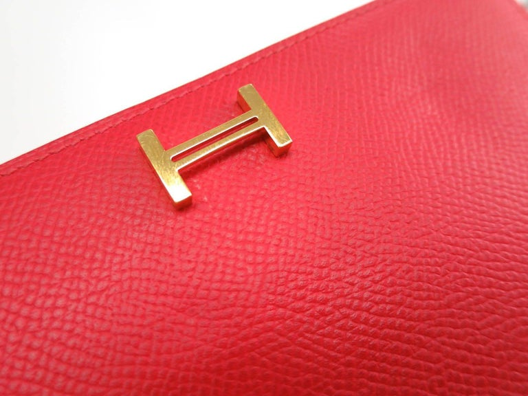 Hermes Red Leather Epsom Leather Gold 'H' Bearn Wallet in Box   Retail price $2,650 Epsom leather Gold hardware Belt closure Made in France Date code Square O (2011)  Measures 6.9