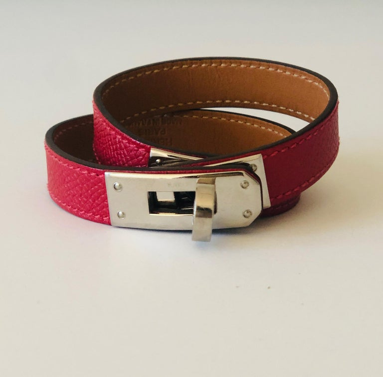 Offered is an Hermes red leather and sliver palladium Craie Epsom Kelly