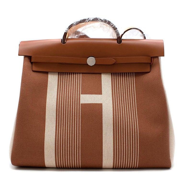 Hermès Retourné HerBag Zip 29 in Toile H Plume H Vibration Canvas and Hunter Cowhide with Palladium Hardware.  2020  Includes Dust Bag, Box, Clochette, Lock and Keys.  Size: 29  L 29 x H 38 x D 11 cm