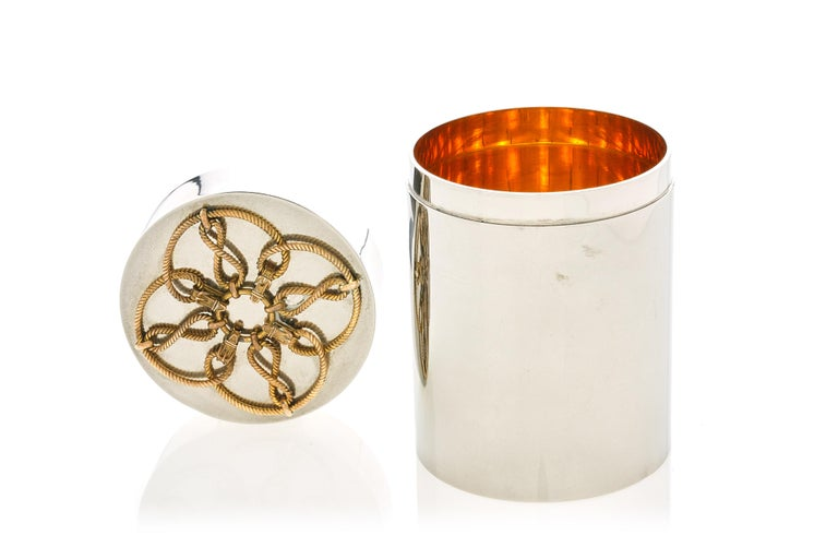 A large cylinder box by Hermes, featuring a gilt-interior with a figural rope top,