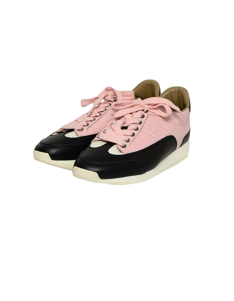 Hermes Rose Aube Pink/Black/White Calfskin Goal Sneakers sz 37.5 rt $1,000  Made In: Italy Color: Pink, black, white Hardware: Silvertone hardware Materials: Calfskin leather Closure/Opening: Lace-up closure Overall Condition: New Estimated Retail: