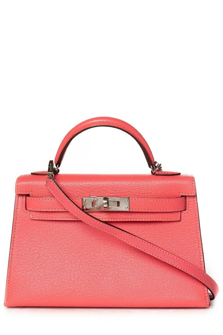 Hermès rose lipstick Chevre leather Mini Kelly Sellier II 20 with tonal stitching, palladium-plated hardware, single top handle, detachable flat shoulder strap, protective feet at base, tonal leather interior lining, single pocket at interior wall