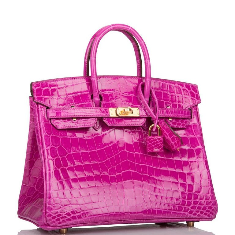 This Birkin is in Rose Scheherazade shiny Niloticus crocodile with gold hardware and has tonal stitching, a front toggle closure, a clochette with lock and two keys, and double rolled handles.     The interior is lined with Rose Scheherazade chevre
