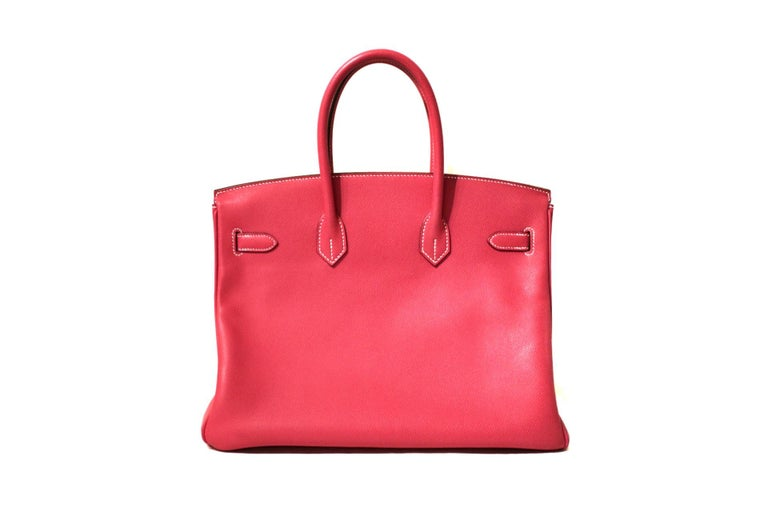 This authentic Hermès Rose Tyrien Epsom 35 cm Birkin is in excellent plus condition.    Considered the ultimate luxury item, the Hermès Birkin is stitched by hand.  Waitlists are commonplace.   Rose Tyrien is a vivid pink pop color for any