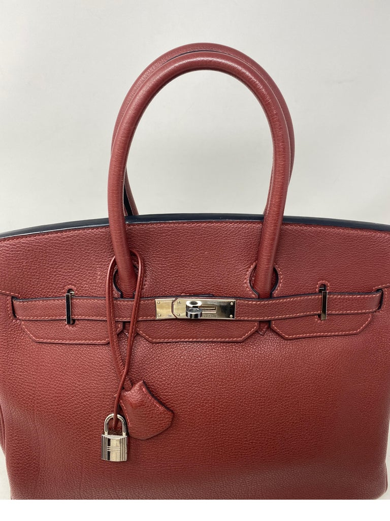Hermes Rouge Birkin 35 Bag. Palladium hardware. Excellent like new condition. Togo leather. G square stamp. From 2003. Kept in dust cover. Beautiful burgundy color. Includes clochette, lock, keys, and dust cover. Guaranteed authentic.