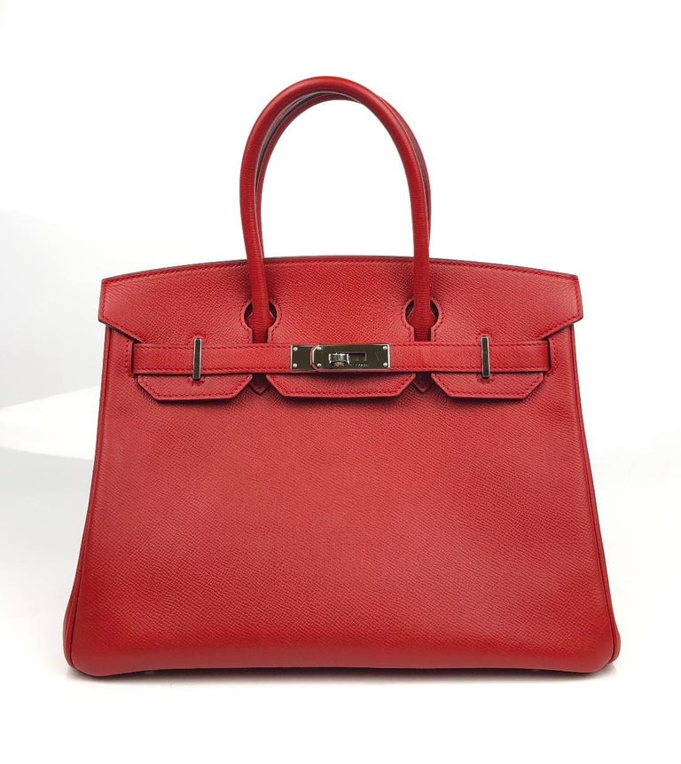 This authentic Hermès Rouge Casaque Epsom 30 cm Birkin is in pristine condition.    Considered the ultimate luxury item, the Hermès Birkin is stitched by hand. Long waitlists are commonplace.   Rouge Casaque is a beautiful red and perfectly accented