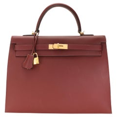 Hermès Rouge H Sombrero Sellier Kelly 35 GHW with Striped Canvas Strap