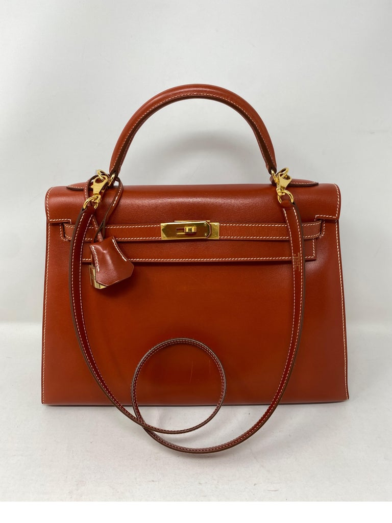 Hermes Rouge Kelly 35 Tadelakt leather. Griss interior. Light grey color interior. White contrast stitching. Beautiful vintage Kelly bag. Collector's piece. Light scratches on front of bag. Sellier shape bag. No slouch at all. A stunner. Rare combo.