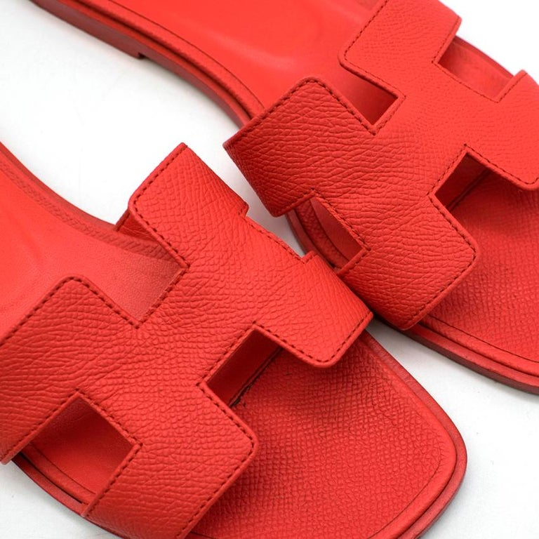 Hermes Rouge Pivoine Epsom Leather Oran Sandals  - Square toe  - Epsom Leather - Iconic H Cut out  - Natural Leather Sole    Made in Italy   Please note, these items are pre-owned and may show signs of being stored even when unworn and unused. This