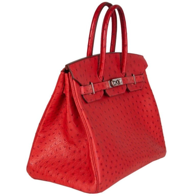 Hermès 'Birkin 35' bag in Rouge Vif ostrich leather. Lined in Chevre (goat skin) with an open pocket against the front and a zipper pocket against the back. Has been carried with slight darkening to the handles and bottom corners. Overall in