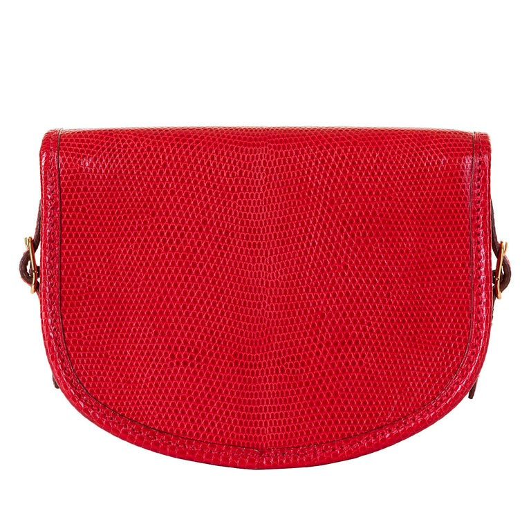 This beautiful, very rare vintage Hermes Mini evening bag, is finished in shiny red lizard, accented with gold hardware. In excellent condition throughout, this 'Tres-Chic bag can be worn as a clutch (as shown in the main image), or as a shoulder or