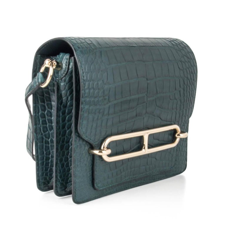 Guaranteed authentic Hermes mini Roulis bag features matte alligator Vert Cypress. Fresh with palladium hardware.  This divine jewel and easily moves from day to night. NEW or NEVER WORN   Comes with signature Hermes box and sleeper.  final sale