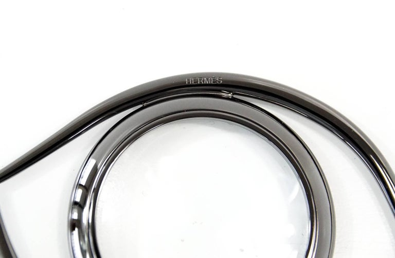 Guaranteed authentic Hermes Eye of Cleopatra magnifying glass / paperweight in ruthenium finished brass. Beautiful blend of form and function, originally designed in the 60's by renowned  French writer and film maker Jean Cocteau. Comes with