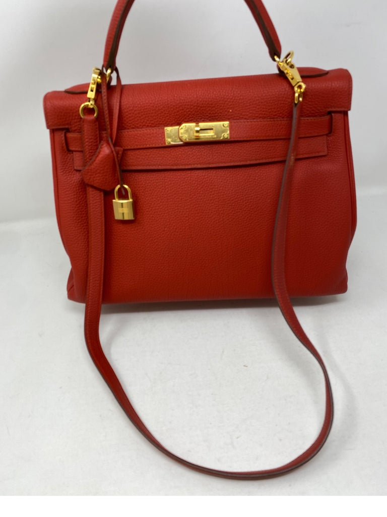 Hermes Sanguine Kelly 32 Bag. Deep red color with gold hardware. Beautiful color. Good condition. Togo leather. Includes clochette, lock, keys and dust cover. Guaranteed authentic.