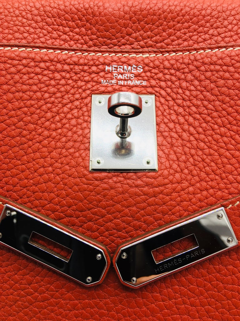 Sanguine is a lovely and highly unusual colour, it's no longer made and hard to come by.  This Kelly 35 is in Taurillon Clemence Leather with Palladium Hardware, and is in very good condition.  Dimensions:   35cm x 24cm high x 12cm (W/H/D) Stamp: