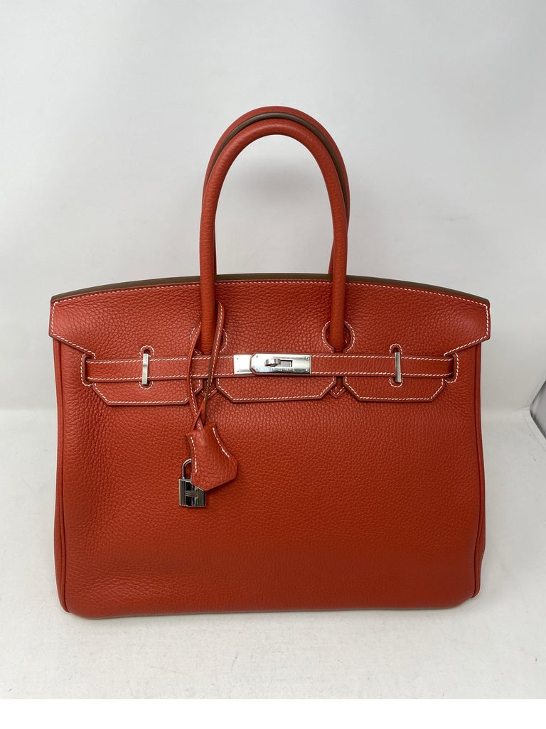Hermes Sanguine Two Tone Birkin 35 Bag. Stunning sanguine red/ brick color with white interior. White leather on bottom. White contrast stitching. Excellent condition. Like new. Rare and limited edition. Palladium hardware. Plastic still on