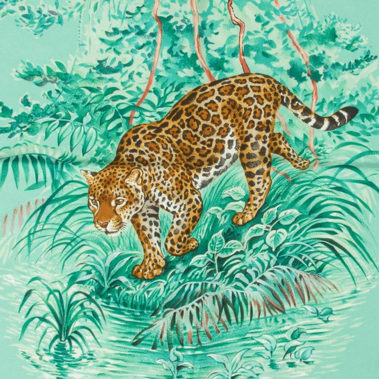 Guaranteed authentic Hermes Equateur Wash Silk Twill scarf by Robert Dallet.   Tropical Aqua, Emeraude and Fauve depicts equatorial animals, birds and plants. This was silk has a velvety feel with a matte ever so slightly faded finish. Incredibly