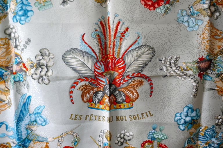 """Hermès Scarf, in 100% Silk, Michel Duchene design """"Les Fetes du Roi Soleil""""   In unworn good condition,   Logo and HERMÈs-Paris The scarf is bright with finely detailed Horse Pictures The Scarf is 34"""" x 34""""  100% Silk with hand rolled hems  F48"""