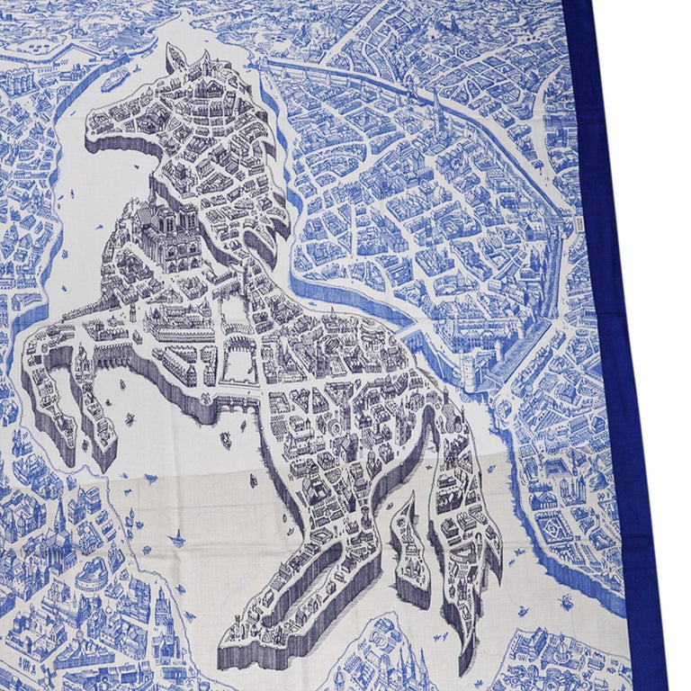 Guaranteed authentic Hermes La Cite Cavaliere Cashmere and Silk scarf by Octave Marsal. Depicts a bird's eye view of Paris with the horse at its heart! Exquisite in Bleu Royal, Blanc and Bleu Encre. Signature hand rolled edge. Comes with signature
