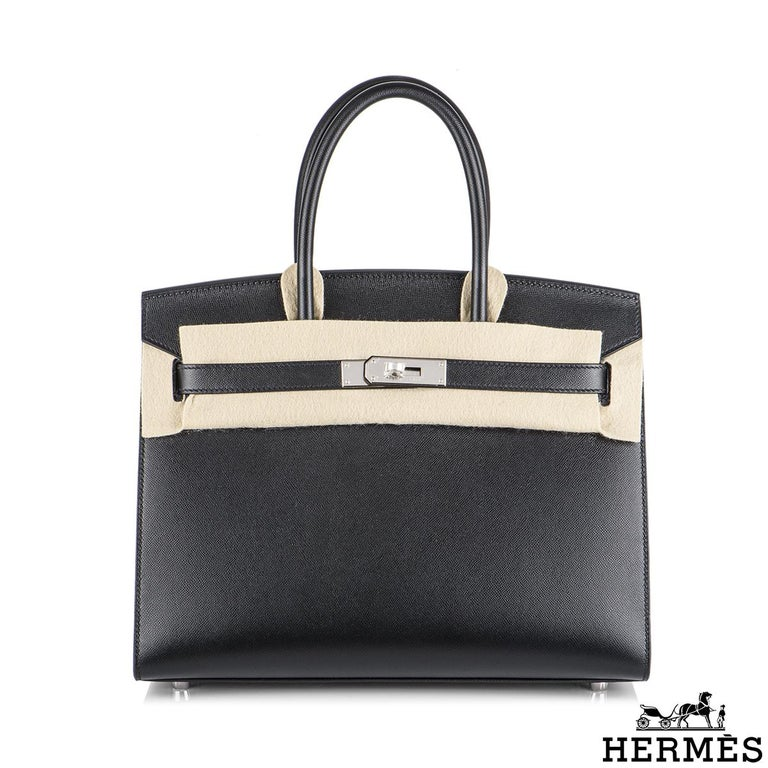 An exquisite Hermès Sellier Birkin 30 bag. The exterior of this birkin features veau madame leather in black. The black leather is complimented with palladium hardware. This birkin is in Sellier style which features topstitching on the outside, this