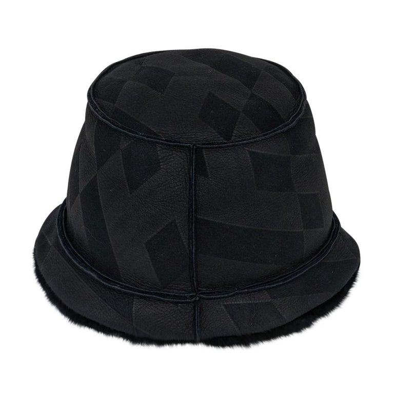 Guaranteed authentic Hermes Black Shearling bucket hat.  Lambskin with stamped abstract black on black design and Shearling inside. Hermes tag inside. Fabulous, rare to find beauty! NEW or NEVER WORN final sale  HAT SIZE  59  CONDITION: NEW or NEVER