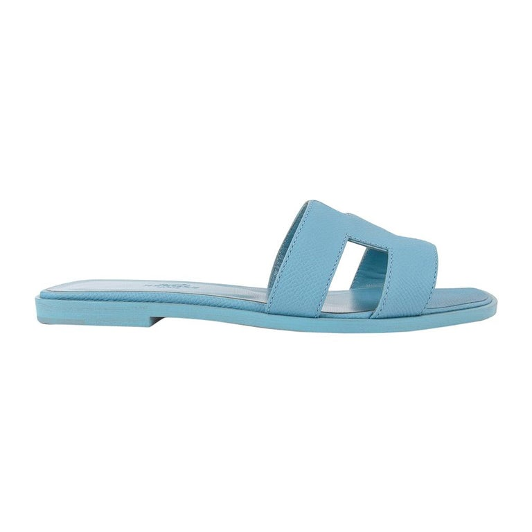 Guaranteed authentic Hermes Oran exquisite Bleu Littoral calfskin slide. The iconic top stitched H cutout over the top of the foot in sublime calfskin. Embossed Bleu Littoral calfskin insole.  Wood heel with leather sole.  Comes with sleepers and