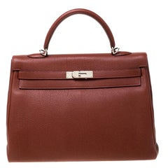 Hermes Sienne Togo Leather Palladium Hardware Kelly Retourne 35 Bag