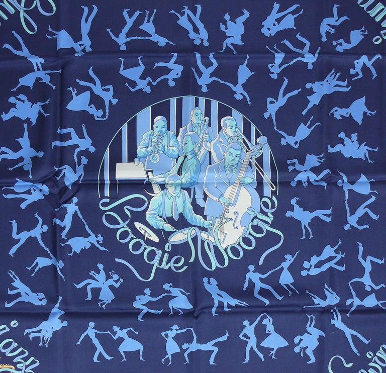HERMES rare silk carré scarf BOOGIE WOOGIE featuring an elaborate design of couples dancing on a navy blue background.  Issued in 2003.  Designed by SOPHIE KOECHLIN.  This scarf features : - Hand rolled borders. - 100 % silk. - Composition and care