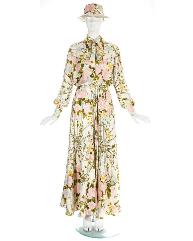 Silk floral maxi shirt dress with matching sunhat  - Button fastenings throughout   - Bishop sleeves  - Internal waist stay   - 'Romantique' floral print  c. 1970s