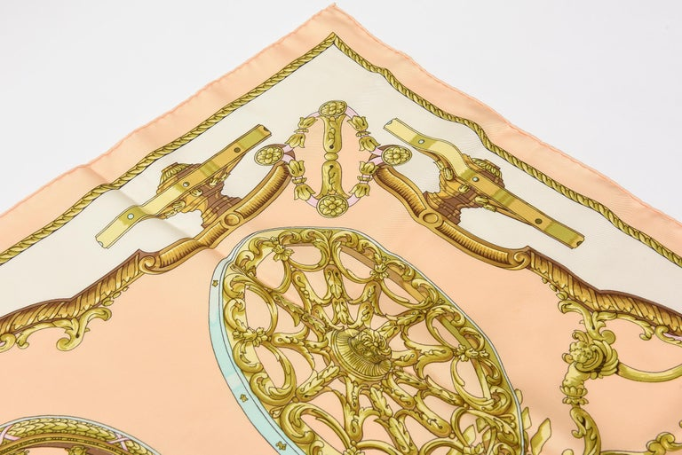 This lovely and spring like French Hermes silk scarf is vintage and has all the labels on it. It has a lightness to it in color palette and pattern. Perfect to welcome in all of the seasons of 2020 and 2021.