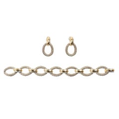 Hermès Silver and Gold Oval Link Bracelet and Earrings, French, circa 1960