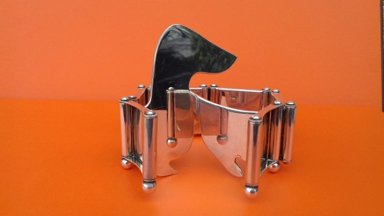 Exceptional Authentic Hermès Photos Holder  Absolutely stunning, a rare collector item  Dachshund shaped, the body is made up of 6 small articulated photos frames  Made in France  Made of Silver Plate