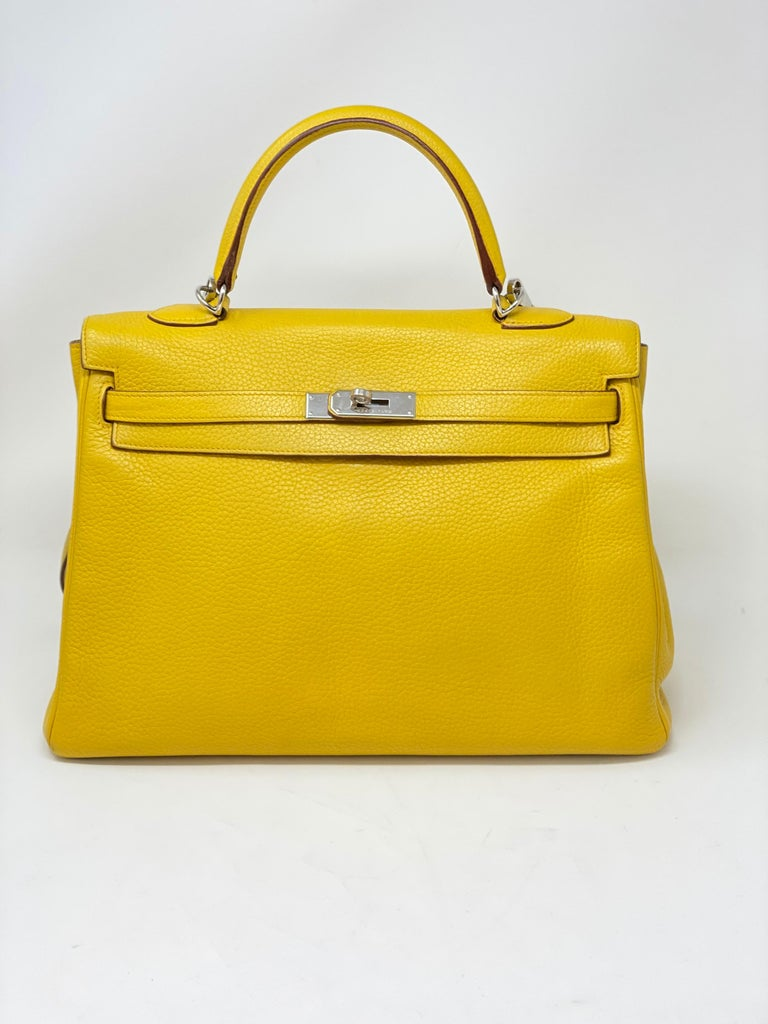 Hermes Soleil Yellow Kelly Bag. Beautiful bright yellow color. Clemence leather. Good condition. Palladium hardware.  Includes dust cover, clochette, lock, and keys. Guaranteed authentic.