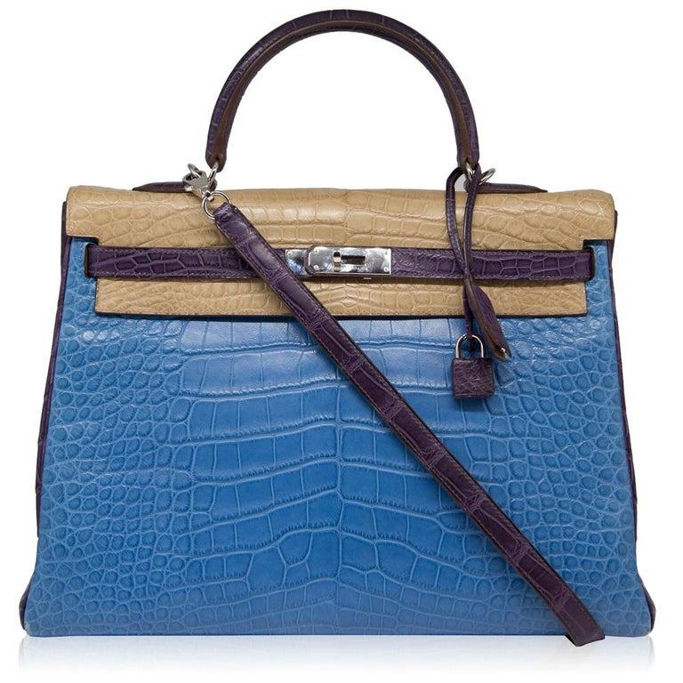 This Special Order 35cm Tri-colour Kelly bag from Hermès is a true testament to the quality of the house's craftsmanship, exuding timeless style and elegance. Crafted from rare leather, a favoured Hermès hide for its large, square, rougher ridged