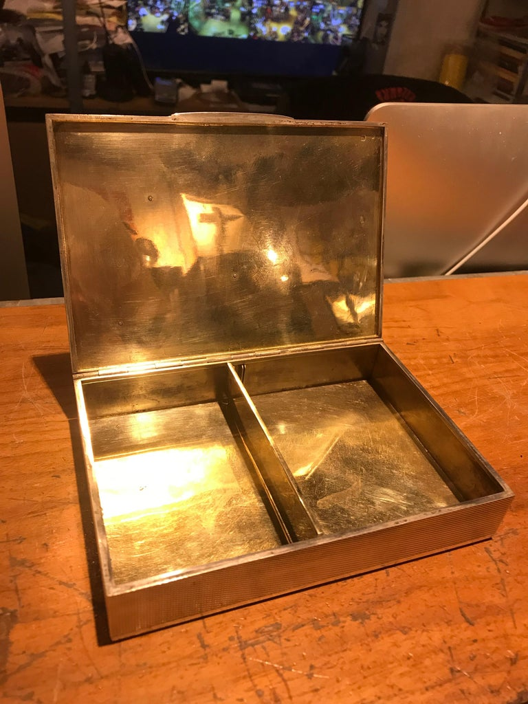 A fine and rare example of a sterling Hermes desk object. Complete with their anchor motif and incredible engine turned texture, this box would be perfect for any coffee table or desk. Fantastic condition and look for its age.